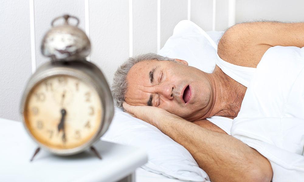 Man Sleeping Through Alarm