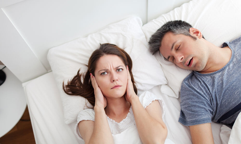 Woman Covering Her Ears | Man Snoring